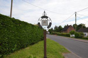 Stoke Holy Cross village sign
