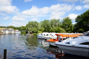 Boats docked in the river in Wroxham