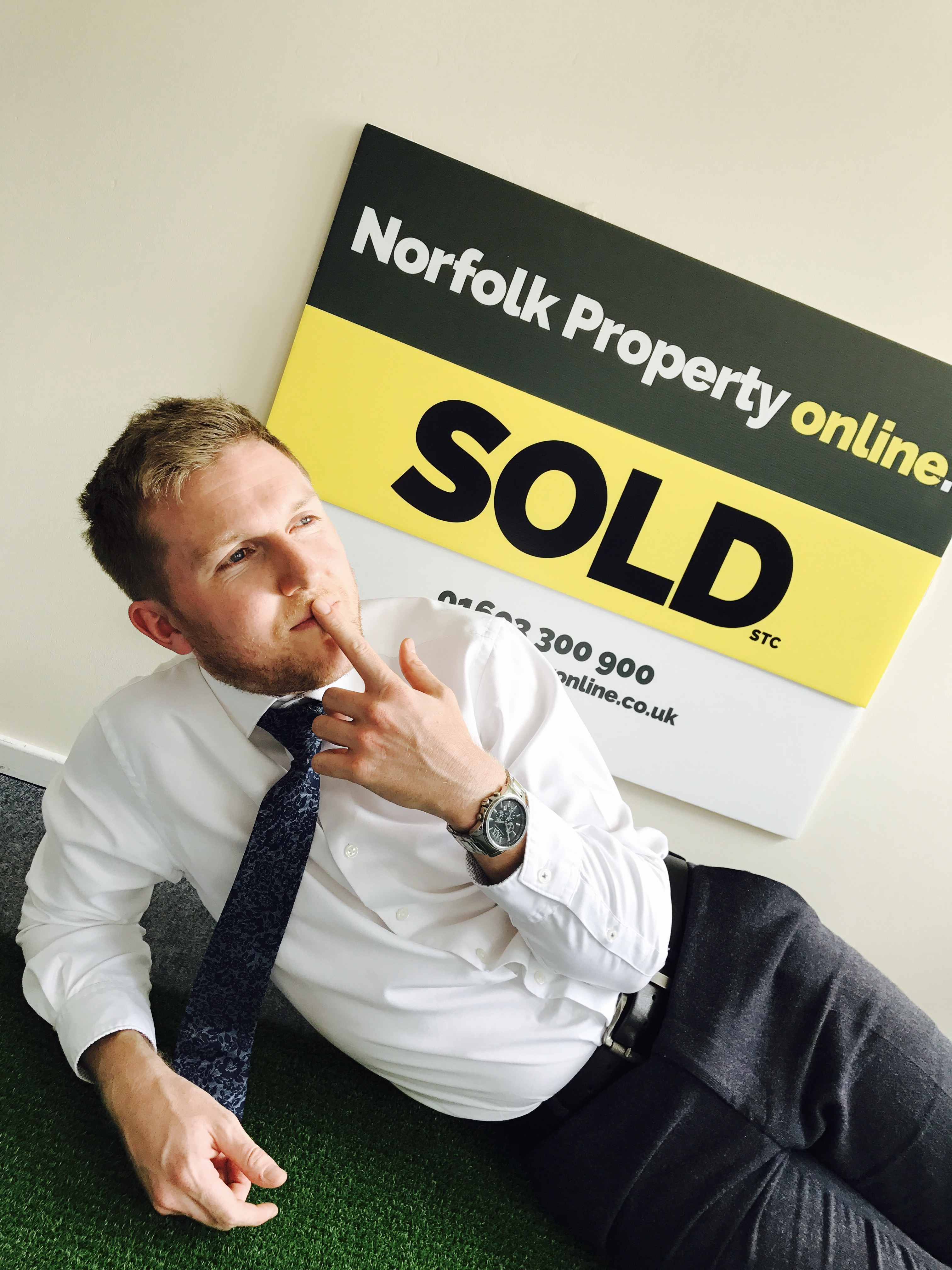 Dan posing infront of a Norfolk Property Online 'for sale' board
