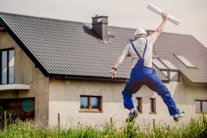 Builder jumping in the air