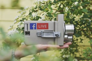 Vintage camera with facebook live on the side